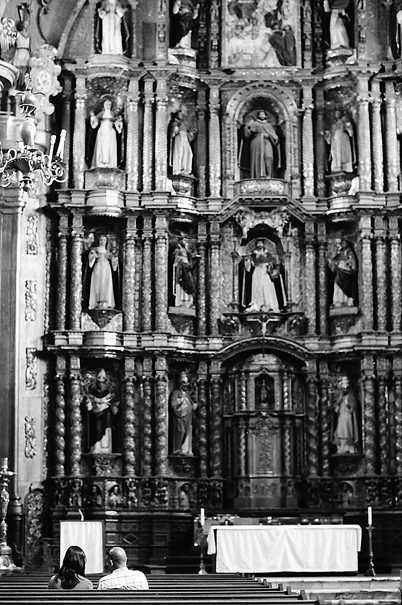 Couple in front of big altar