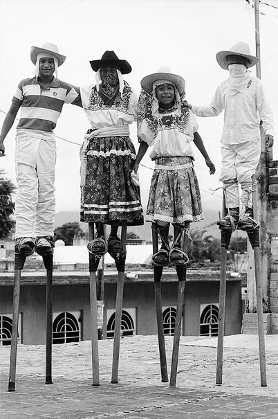 Boys Walking On Stilts (Mexico)