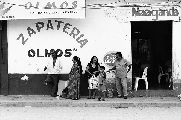Family in front of shoe shop