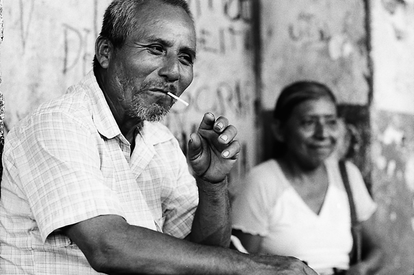Man putting cigarette into mouth