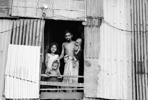 Family standing by window