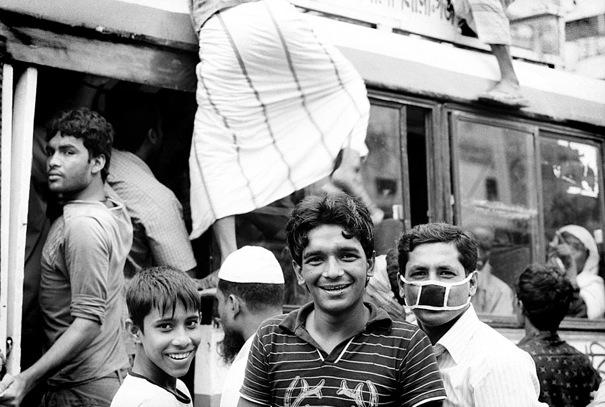Three Men At A Bus Stop (Bangladesh)
