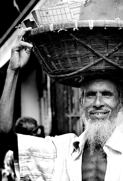 Man carrying with basket on head