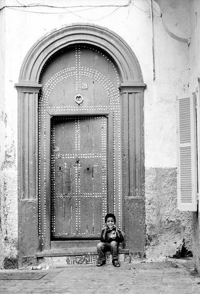 Boy In Front Of The Heavy Door (Morocco)