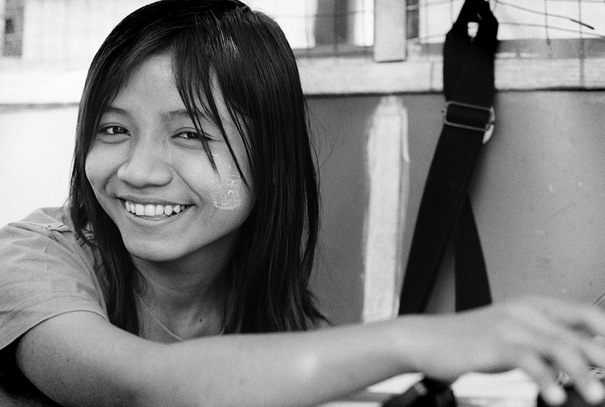 Smile Of A Girl Working At A Call Stand (Myanmar)