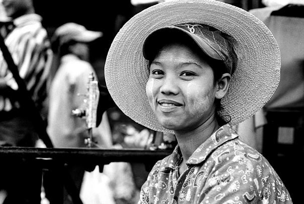 Woman wearing cap and hat
