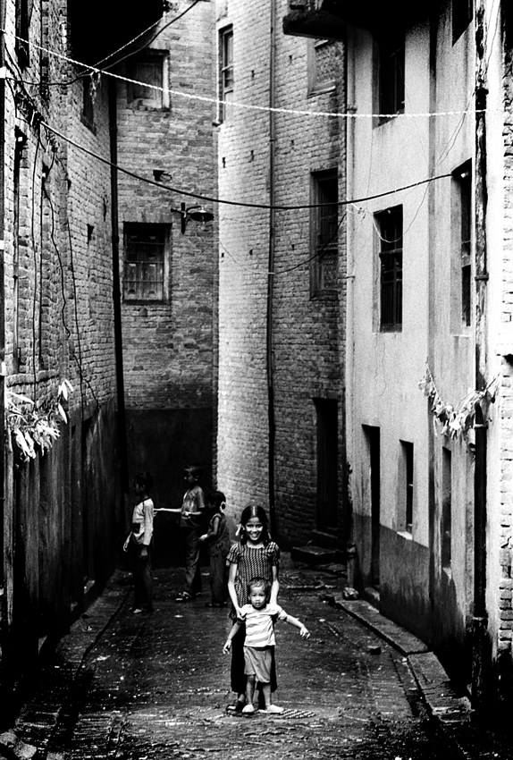 Kids playing in dim alley