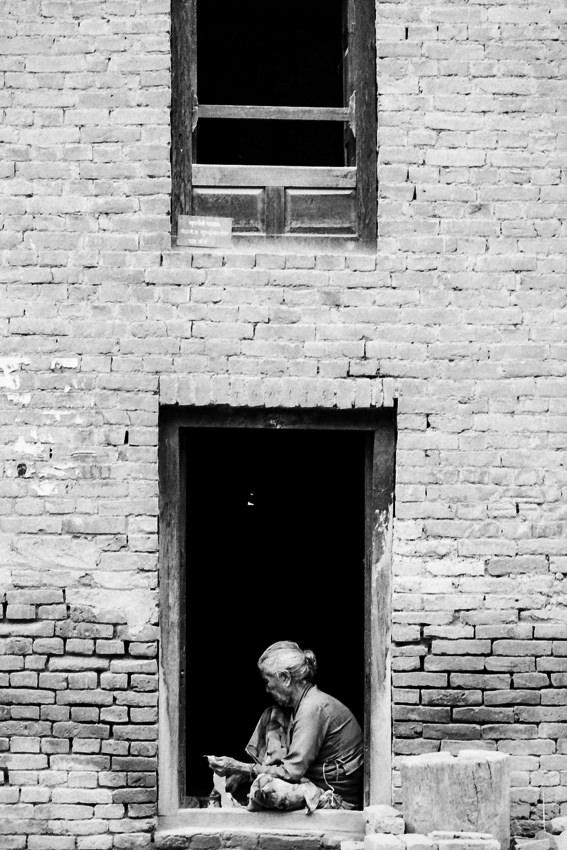 Older woman working at door