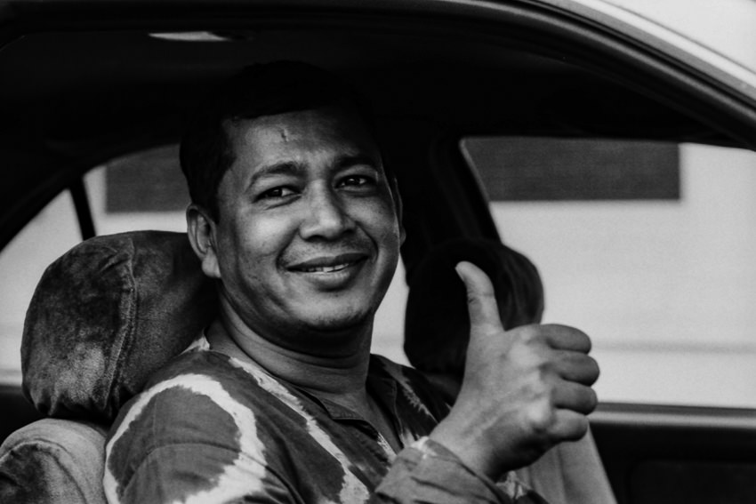 Taxi driver thumbing up