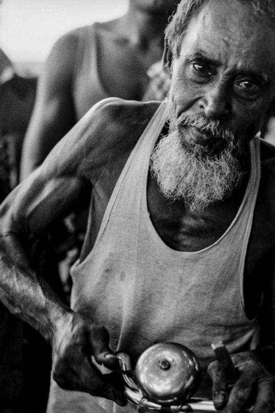 Man ringing bell of cycle rickshaw