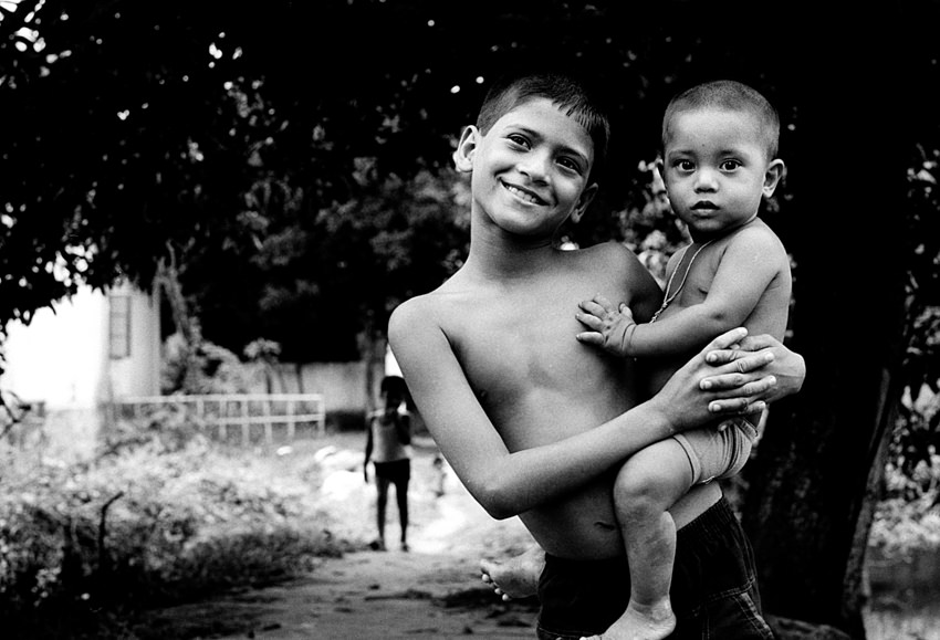 boy holding little brother