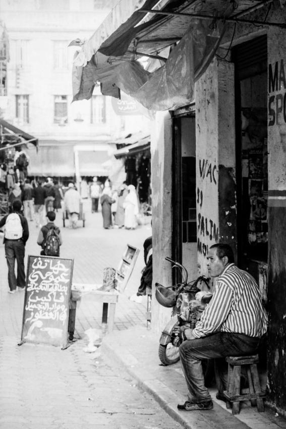 Man sitting in storefront