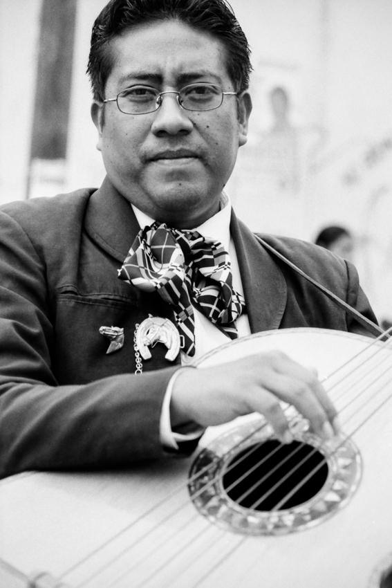 Man holding guitarrón