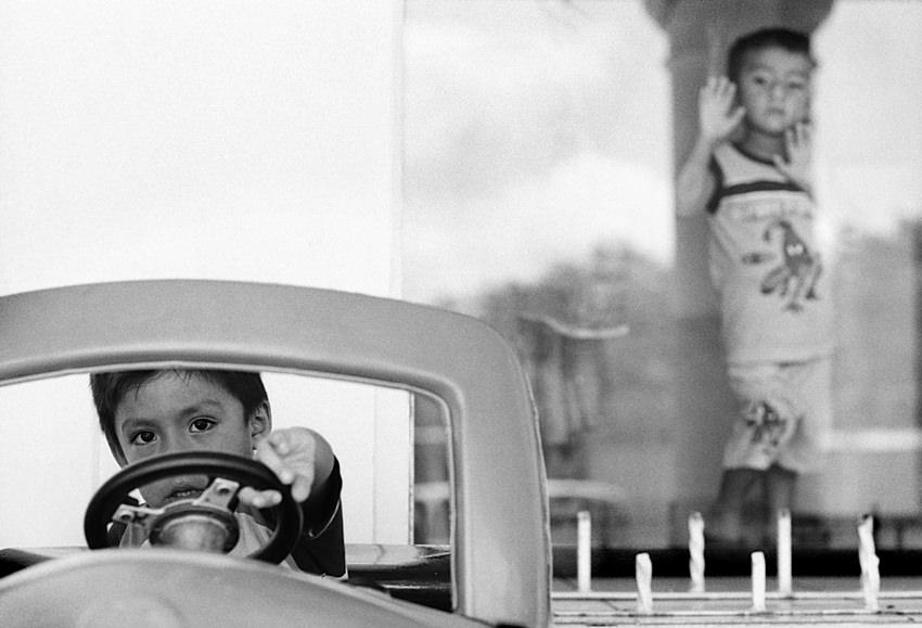 boy driving toy car