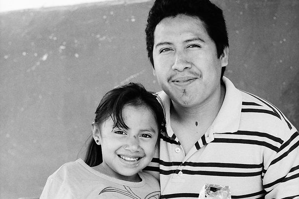 Father and girl smiling together