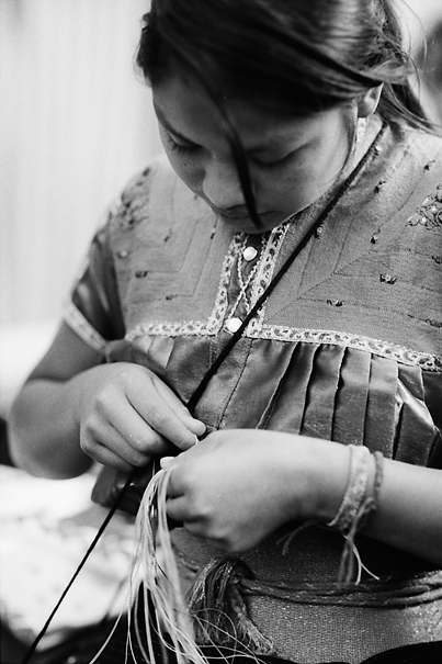 Young woman stitching