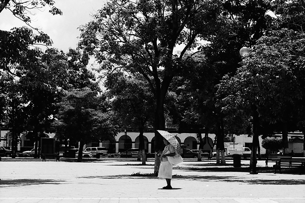 Older woman stopping in square