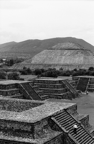 Man standing on stairway of pyramid