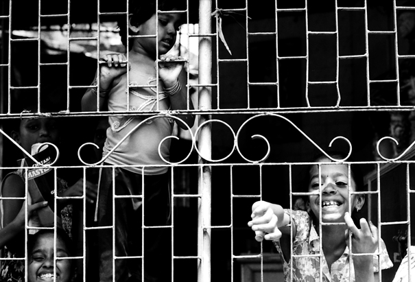 Children In The Other Side Of The Wire Netting (India)