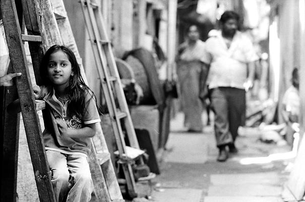 Girl sitting on ladder