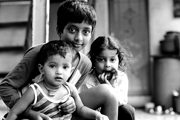 Three Kids Sitting Together (India)