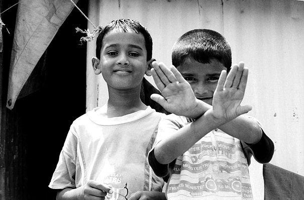 Cross-handed Boy And His Friend (India)