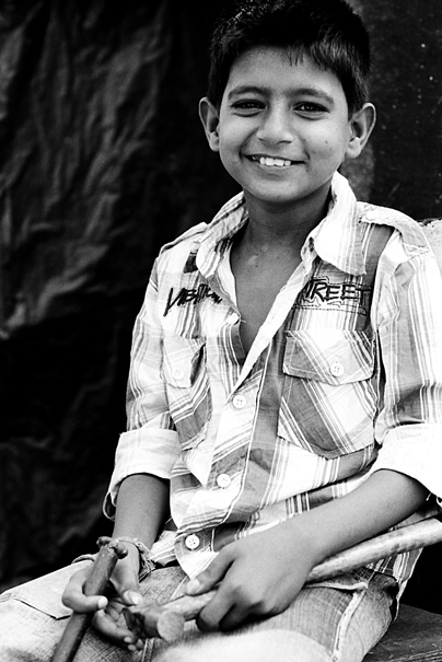 Smile Of A Boy Who Had Hammers (India)
