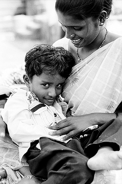 Boy Nestling In The Mother's Arm (India)