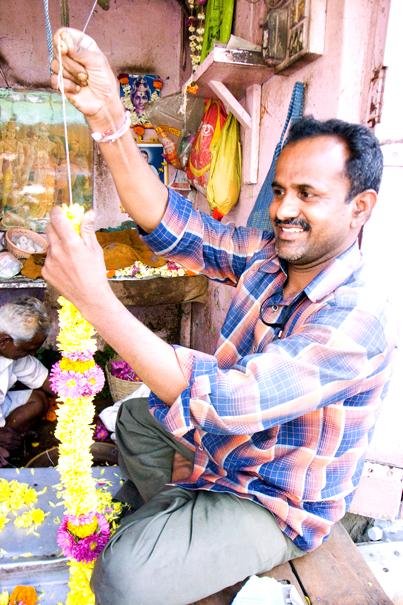 Man Making Wreaths @ India