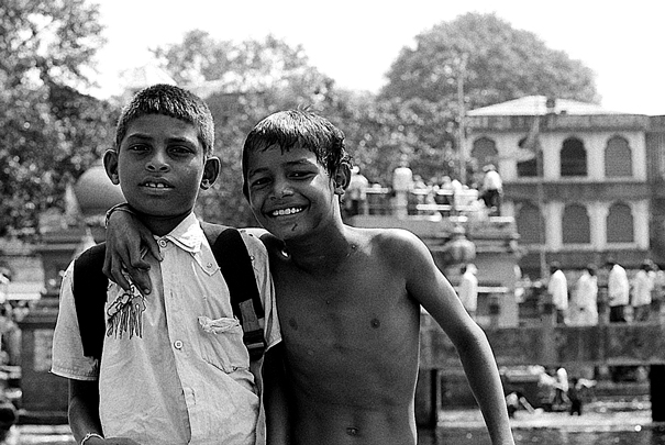 Boy Wearing A Clothes And Boy Stripping To The Wasit (India)