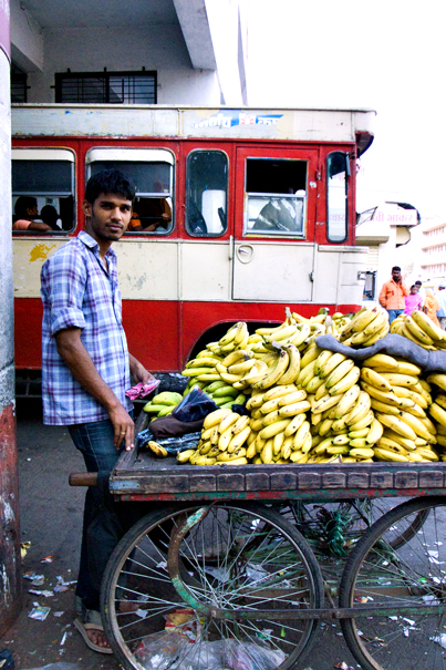 Man Selling Bananas In The Bus Terminal (India)