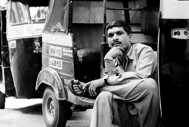 Driver Of Autorickshaw Sat Cross-legged (India)