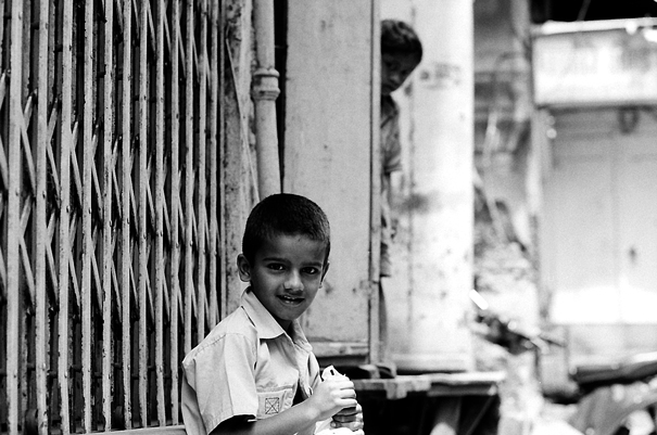 Boy Sitting By The Wayside (India)