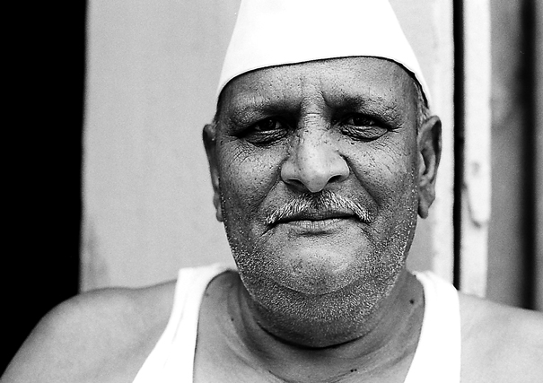 Man wearing Gandhi cap