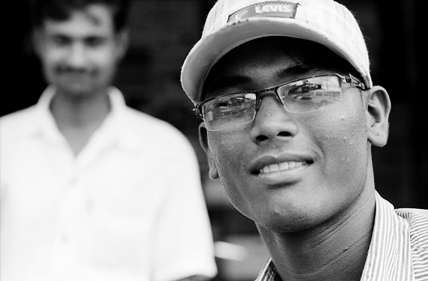 Young man wearing glasses and cap