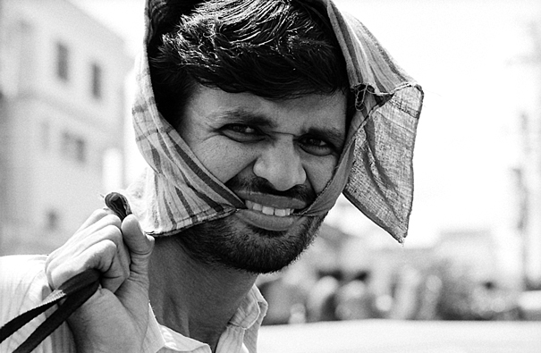 Man Biting The Edges Of His Towel (India)