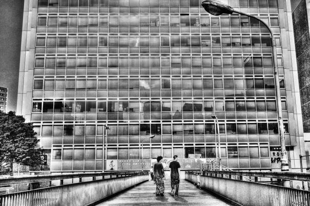 Two men on pedestrian bridge