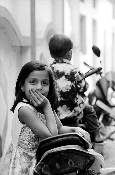 Girl Putting Her Elbows On The Motorbike (India)