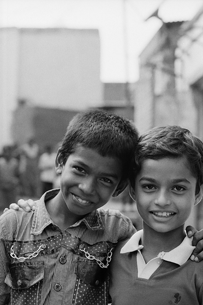 Two Smiling Boys Standing Together (India)