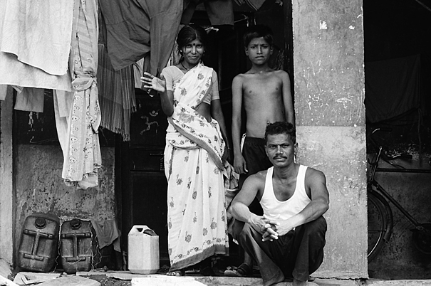 Family In Front Of Their House (India)