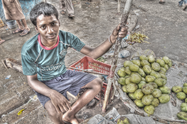 Boy selling mango