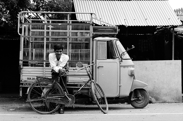 Man leaning against bicycle