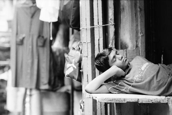 Boy sleeping with head on arm