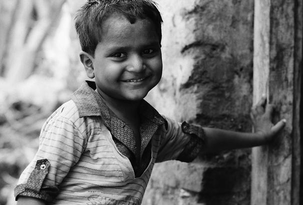 Boy placing hand on wall