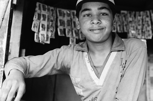 Young man in small shop