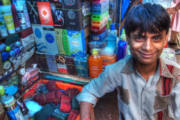 Young Man At A Street Stall (India)