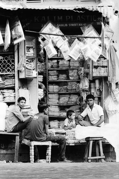 Men Relaxing In A Shop @ India