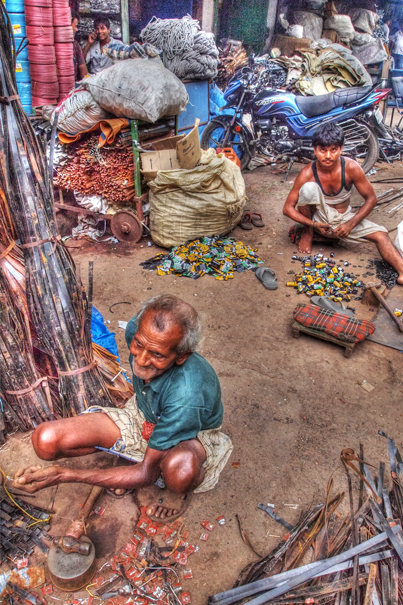 Men working among scrap iron