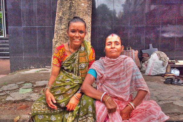 Two women wearing saree