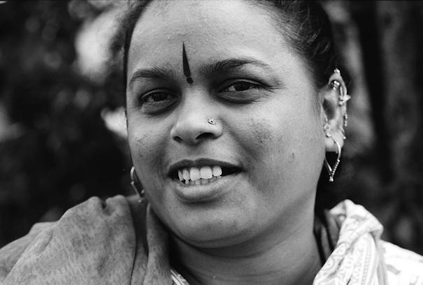 Woman wearing many pierced earrings